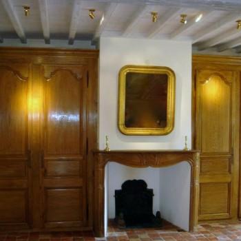 Aménagement d'une pièce en boiseries anciennes