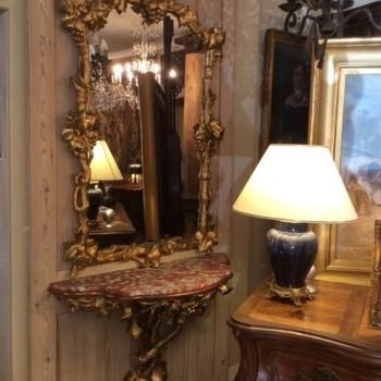 Glace en bois doré et sa console 19ème siècle
